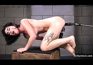 Messy brunette pounds pussy with machine