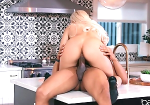Sexy blonde anally rides lover's BBC in rub-down the kitchen
